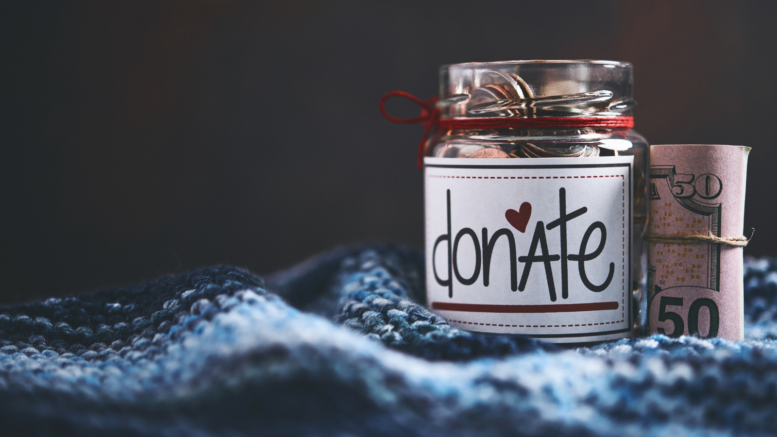 Photo of donation jar with money
